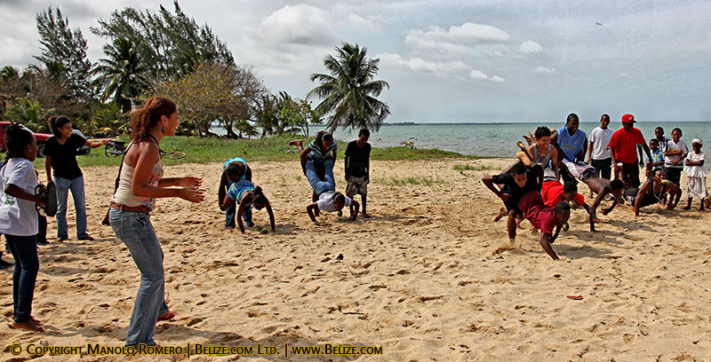 kids wheelbarrow race hopkins beach belize