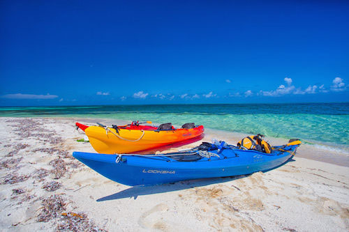 Sea kayaks at Belizean beach.