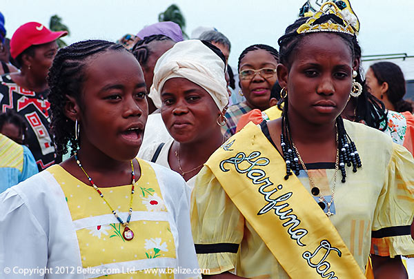 Garifuna Settlement Day Queens in southern Belize wearing traditional Garifuna color dress.